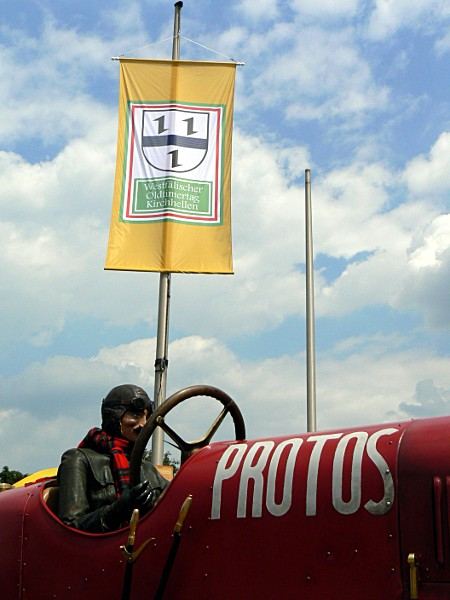 Protos in front of flag